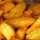 Reteta de post: Cartofi la cuptor cu boia, chimen si usturoi