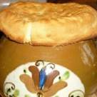 Reteta boiereasca: pui sub capac de paine